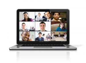Picture of a notebook computer with people participating in a web meeting