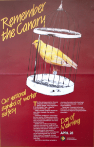One of the original April 28th National Day of Mourning posters showing a canary singing in a cage, reminding us of the canaries used in the past in coal mines to detect hazardous gases.