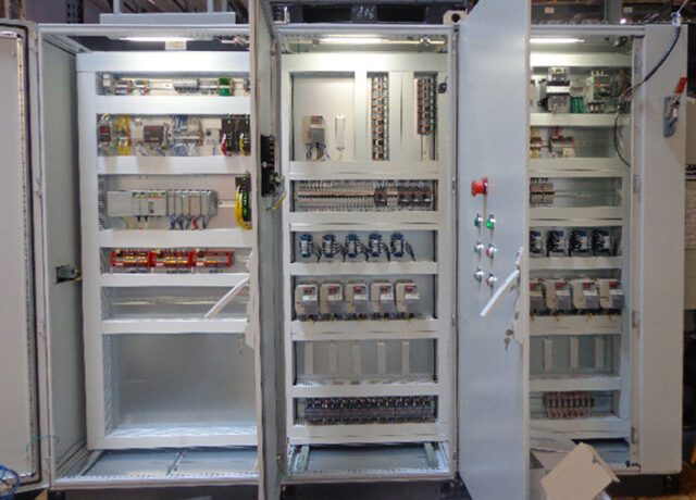 Photo of the interior of an electrical control cabinet showing the components and wireways on the backplane.